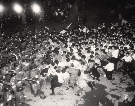 Screaming mobs of Japanese radical students invaded parliament's grounds and engaged in a bloody free-for-all with police using fire hoses and clubs in Tokyo, June 15, 1960. Shouting against pro-American Prime Minister Nobusuke Kishi and hurling chunks of pavement at some 1,000 police, hundreds of students surged into the grounds through the south gate after tearing down the heavy gates and setting fire to a police truck blocking their way. More than 300 were reported injured and two dead, one confirmed, in worst flare-up of violence since Japan's left wing launched a massive campaign against the prime minister and the U.S.-Japan Security Treaty. Rioting leftists Zengakuren and police betting in front of the south gate of the Diet (Parliament) Building. (AP Photo)