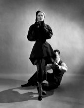Designer Charles James pinning a suit on model (possibly Ricki Van Dusen)