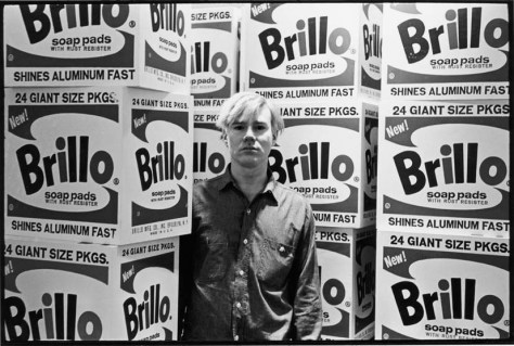 American pop artist Andy Warhol (1928 - 1987) stands amid his towering Brillo box sculptures in the Stable Gallery (33 East 74th Street), New York, New York, April 21, 1964. (Photo by Fred W. McDarrah/Getty Images)