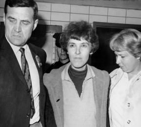 UNITED STATES - JUNE 03: Detective Frederick Stepat and policewoman McCarthy escort Valeria Solanas, 28, into 13th pct, for the shooting of Pop Art movie man Andy Warhol at his 33 Union Square West office. Valerie surrendered to a cop in Times Square, allegedly admitting shooting, and saying:(34)I am a flower child.(34) Warhol is in critical condition. His associate, Mario Amaya of London, was also shot. (Photo by Frank Russo/NY Daily News Archive via Getty Images)