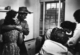 USA. Colorado. 1948. Parents watch Dr CERIANI treating their daughter. Dr. Ernest Guy CERIANI, a country doctor (aged 32), takes care of all the people in the town of Kremmling and in the 400 miles surrounding the town.