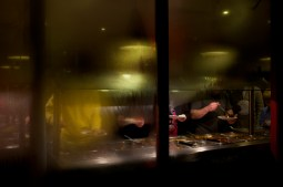 Diners at self-service Chinese buffet through steamed window