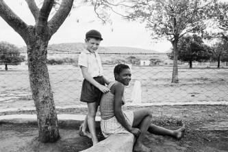 A farmer's son with his nursemaid, Heimweeberg, Nietverdiend, Western Transvaal. 1964. David Goldblatt/Goodman Gallery