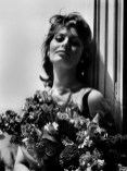 FRANCE. 12th Cannes film festival. Italian actress Sophia LOREN poses with flowers on the balcony of the Carlton hotel on May 13, 1959.