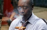 "In this Jan. 15, 2016 photo ""House of Lie""s actor Don Cheadle smokes a cigar outside the Bodeguita Del Medio bar during a shoot of an episode in Havana, Cuba. Producers of ""House of Lies"" and other productions shot in Cuba said the 55-year-old U.S. trade embargo on Cuba posed the primary obstacle to U.S. entertainment companies' hopes to the island into a tropical backdrop. But particularly Cuban difficulties could also prevent U.S. productions from regularly working on the island. (AP Photo/Desmond Boylan)"