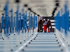 Cuba's Dayron Robles competes in the men's 110m hurdles final of a local athletics competition at the Pan American Stadium in Havana, May 27, 2012. Robles, current world record holder in the event and gold medalist in the Beijing Olympics, told Reuters that he will retire after the 2012 Games in London. Picture taken May 27, 2012. REUTERS/Desmond Boylan (CUBA_