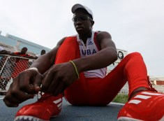 Cuba's Dayron Robles gets ready to compete in the men's 110m hurdles final of a local athletics competition at the Pan American Stadium in Havana, May 27, 2012. Robles, current world record holder in the event and gold medalist in the Beijing Olympics, told Reuters that he will retire after the 2012 Games in London. Picture taken May 27, 2012. REUTERS/Desmond Boylan (CUBA_