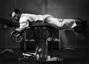 USA. Colorado. 1948. Dr CERIANI resting on an operating table. Dr. Ernest Guy CERIANI, a country doctor (aged 32), takes care of all the people in the town of Kremmling and in the 400 miles surrounding the town.