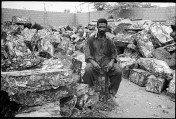 Aslam Khan warehouse yard, Shershah, Karachi, Pakistan. Sher Shah in Karachi is one of the principle markets for second hand and scrap materials where all sorts of electronics, electrical, spare parts, are smuggled. Goods arrive by sea and land, non-usuable waste is crushed into cubes .The presence of these cubes dumped alongside water bodies or the disposal at landfills are extremely injurious to all living beings including humans.