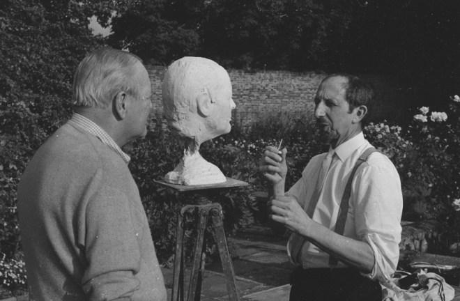 Randolph Churchill being sculpted by Oscar Nemon in a garden