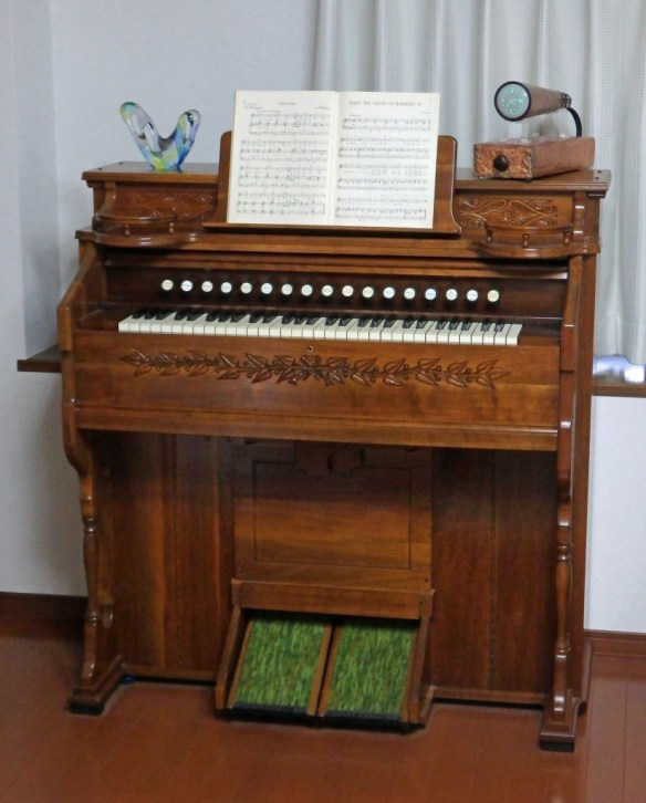 ... or perhaps atop a vintage Estey pump organ?