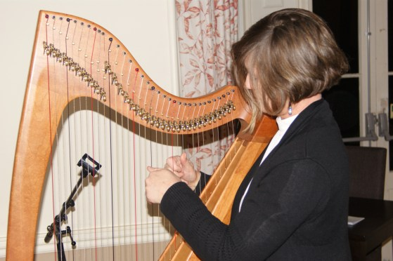 Fraya Thomsen tunes the harp
