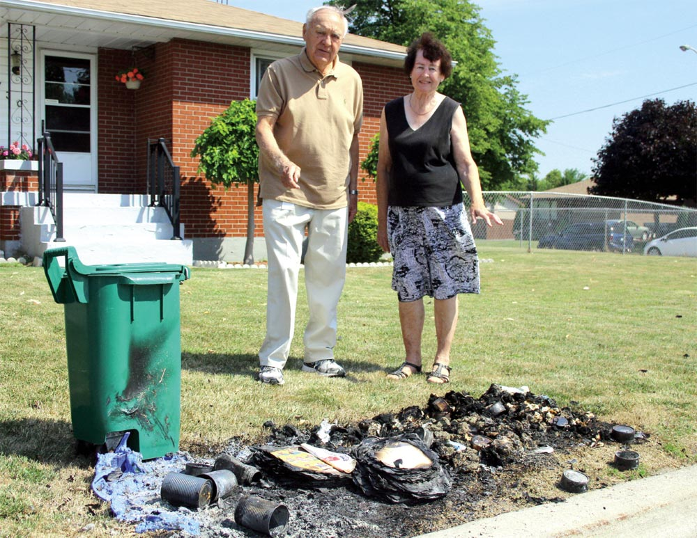 Oshawa resident Alice Robinson, joined here by Council Nester Pidwerbecki, woke up to find the garbage and recycling she had left out the night before for collection had been set on fire.