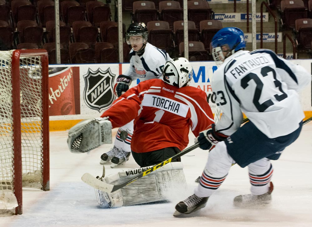 Nathan Torchia makes a twisting save during the Oshawa Generals orientation camp in April.