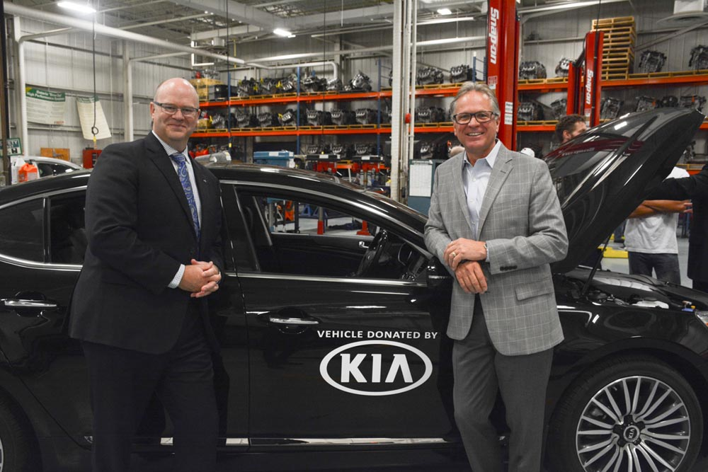 Ted Lancaster, the chief operating officer for Kia Canada, and Don Lovisa, the president of Durham College, introduce the 2014 Kia Cadenza donated by the automaker to the school's automotive programs. Lovisa says cars such as these, filled with new technologies, gives students a headstart when it comes to entering the workforce.