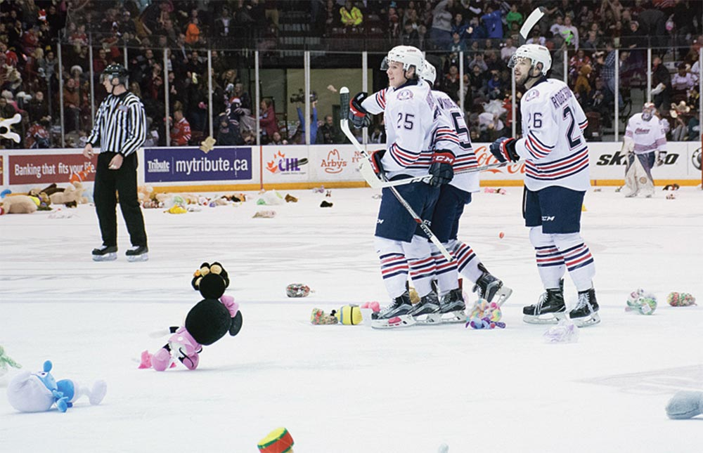 HERE COME THE BEARS: Gens Kenny Huether, Mitch Vande Sompel and Daniel Robertson look on after a goal by Vande Sompel led to thousands of teddy bears flooding the ice at the Tribute Communities Centre. The bears will be donated to the Durham Children's Aid Foundation.