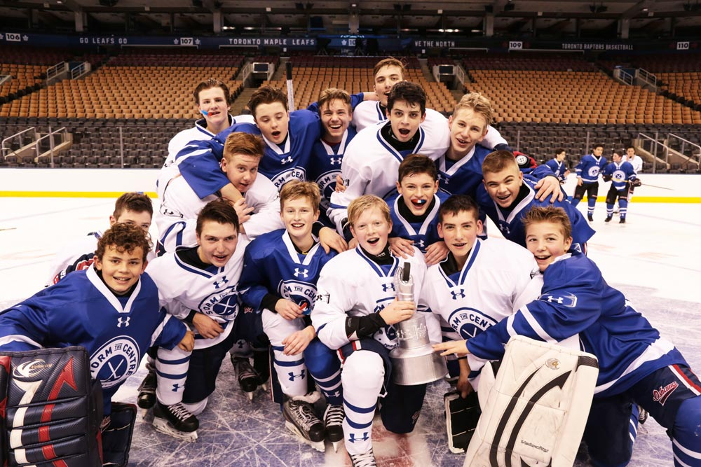 The Oshawa Minor Generals Bantam AE team pile together on the ice at the Air Canada Centre after taking part in Under Armour's Storm the Centre competition.