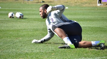 Earl Edwards Jr. recovers after a blocked shot during goalkeeper drills prior to Orlando City SC media day on Friday, February 26, 2016. (Victor Ng / Orlando Soccer Journal)