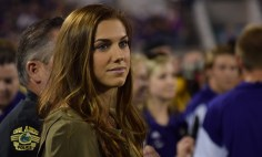United States national women's team star Alex Morgan looks on during pregame festivities of the Orlando City-Chicago Fire match in the Orlando Citrus Bowl on Friday, March 11, 2016. Morgan was the honorary guest for the coin flip in the eventual 1-1 draw. (Victor Ng / Orlando Soccer Journal)