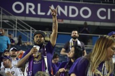 A fan raises his hand in preparation to cheer on the Orlando City Lions in a match against the Chicago Fire in the Orlando Citrus Bowl on Friday, March 11, 2016. The match ended in a 1-1 draw. (Victor Ng / Orlando Soccer Journal)