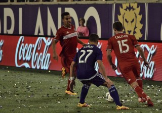 Rafael Ramos (middle) defends Joey Calistri (right) as Brandon Vincent (left) comes to Calistri's aid in a match between Orlando City and the Chicago Fire in the Orlando Citrus Bowl on Friday, March 11, 2016. The match ended in a 1-1 draw. (Victor Ng / Orlando Soccer Journal)