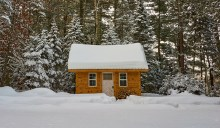 Photo of cabin in the snow