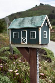 Photo of a mailbox shaped like a house