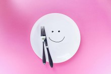 Smiling plate with knife and fork