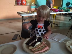 Amelia getting her fair share of cake