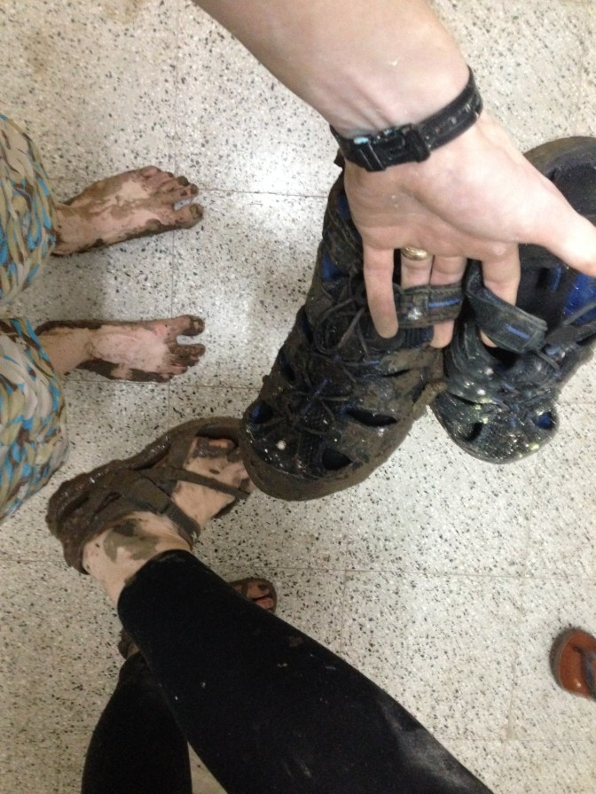 Our super muddy feet/shoes after the river