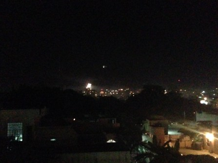 The little dot of light in the distance is a temple at the top of a mountain overlooking the city