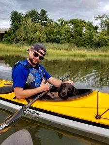 Will Steinharter and dog Surrey kayaking