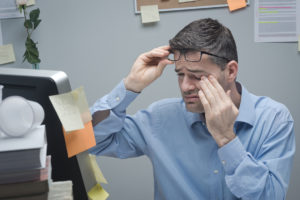 Office worker with eye pain