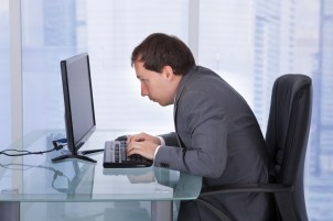 man sitting over computer