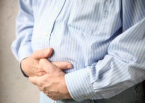 Businessman with bloating and bad stomach pain
