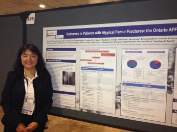 Dr. Angela M. Cheung, Director of University Health Network/Mount Sinai Hospital Osteoporosis Program, next to a poster describing outcomes such as quality of life, pain, and disability in individuals who are part of the Ontario Atypical Femur Fracture (AFF) Cohort.