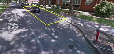 Metered parking spaces along 30th Street near West Hall