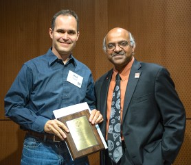 Chemistry Department Chair Rich Carter receives the Milton Harris in Basic Research
