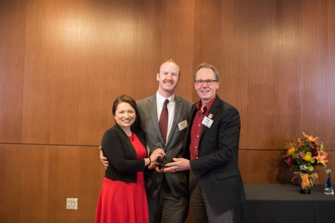 Luisa and Nathan Snyder receiving the Young Alumni Award from College of Science Dean Roy Haggerty.