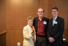 Distinguished Service Award recipients Kay Merrill and Lee Sickler with Dean Roy Haggerty (center).