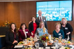 Young Alumni Award recipients Nathan and Luisa Snyder (standing).