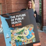 Head Advisor Erin Heim with poster of College of Public Health logo