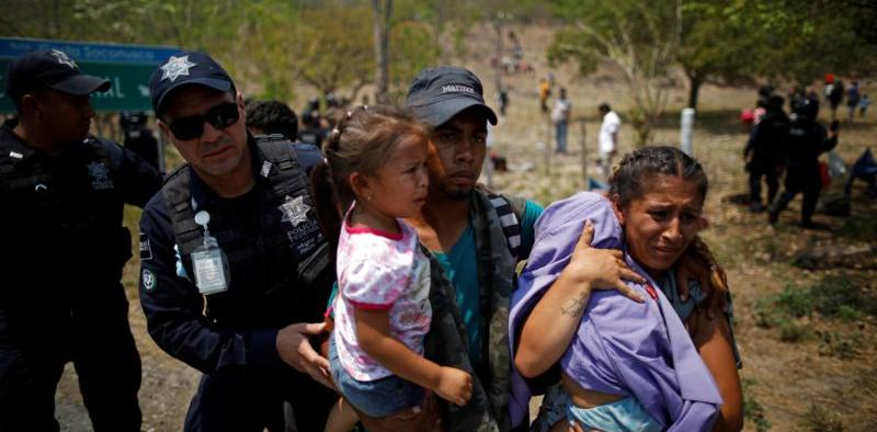 A family of Central American migrants is detained by Mexican federal police officers