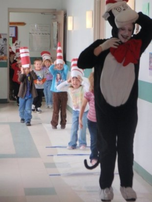 Cat in the Hat and the children read the story Hop on Pop and proceeded to hop on bubble wrap down the hallway
