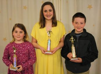 Earning the team's Most Valuable Award are, from left: Hayden Williamson, Grace Trepasso and Tavish Johnston.