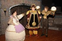 "Word spreads quickly that a girl is in the castle - perhaps THE girl who can bring love to a beast's heart and break a magic spell. The Beast's servants, now enchanted objects, long to be ""human again."" Discussing the news are Mrs. Potts (Clare Bawarski), Cogsworth (Zachary Mizener) and Lumiere (Neil Devendorf). Photo by Dave Dayger."