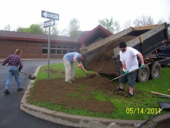 Pictured are Mike Krause, Doug MacDougall, and Jeremy Ellis preparing the lot for planting at Seneca Manor.
