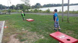 Kids enjoy lawn games at the Lake Neatahwanta trail reveal hosted by Friends of Fulton Parks and OCO.