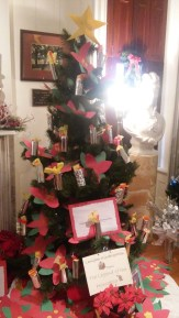 Lanigan kindergartener students submit a tree decorated to the theme: The Legend of Poinsettia.