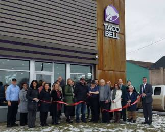 An official ribbon cutting ceremony opened Taco Bell for business in Fulton on Wednesday, January 16.